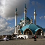 Wedding party assembling for photo call in front of Great Mosque, Kazan, Tatarstan, Russia