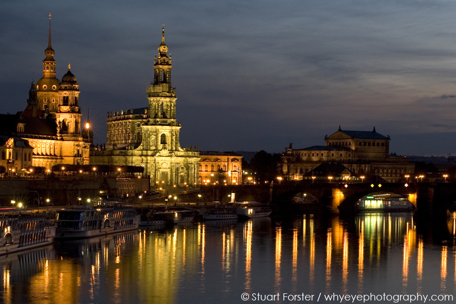 Looking over the river Elbe towards the illuminated Altstadt of Dresden. The historic Altstadt is illuminated at night, when the boats that take river criuses along the Elbe during the day, are moored.