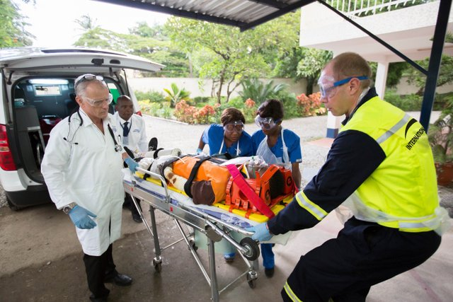 patient on a stretcher being taken into a hospital