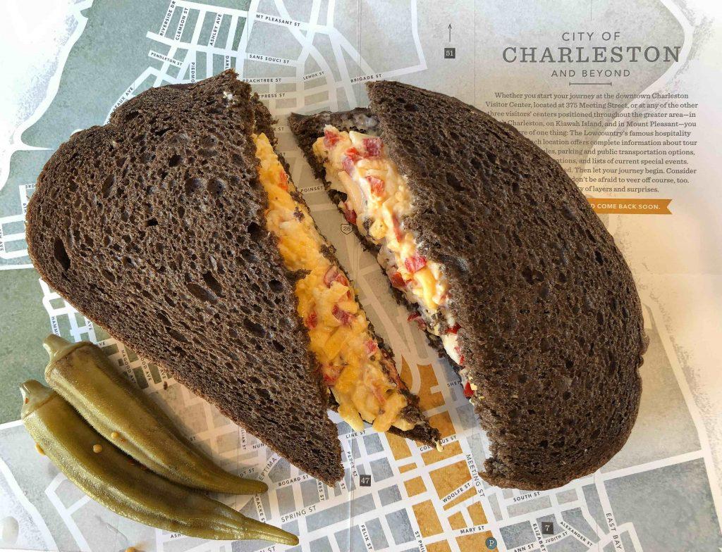 pimento cheese sandwich on dark rye bread on Charleston map