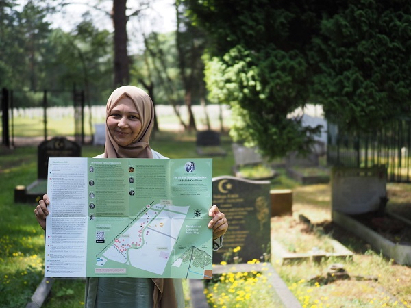 Woman holding map of one of Britain's Muslim Heritage Trails