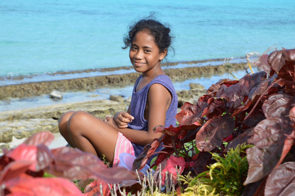 Young person on a beach in Samoa by Petra Shepherd.