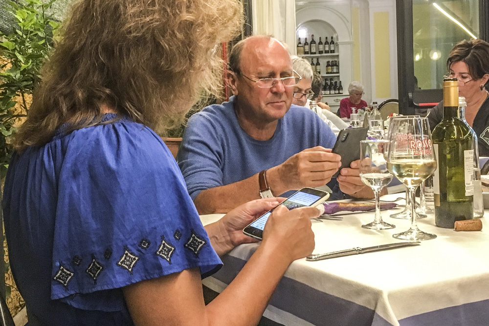 People dining in Tuscany by Valery Collins