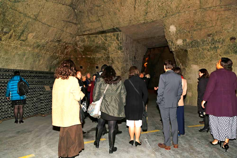Guild members learning about the cultural heritage of the Champagne region during a visit to the cellars where Veuve Clicquot Champagne is produced